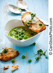 Green pea soup with goats cheese crostini