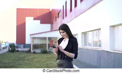 Young businesswoman using phone on the street full HD