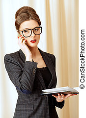 comunication - Portrait of a beautiful business lady talking...