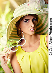 femininity - Romantic young woman in a beautiful hat and...