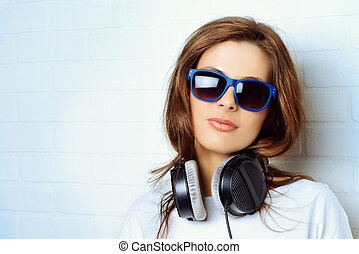 radio music girl - Modern young woman listening to music on...