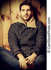 western style - Vogue shot of a handsome male model in jeans...