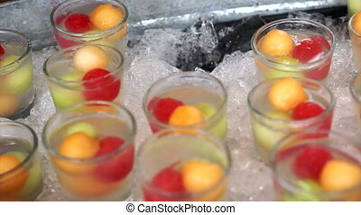 Iced fruits party summer cocktail - Iced fruits scoop. Cold...