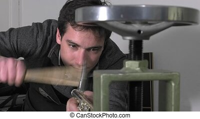 a craftsman recovering a flute - straightening on a mandrel...