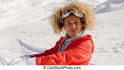 Close up of cheerful woman on snowy hill - Close up of...