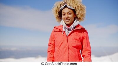 Young skier tilting her head to the side