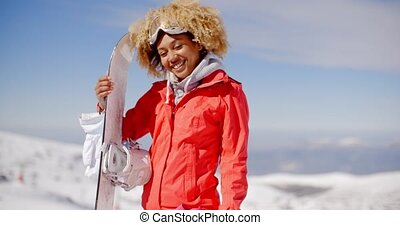 Confident skier with skis and gloves on hill - Cute skier...