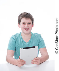 young boy playing with tablet pc