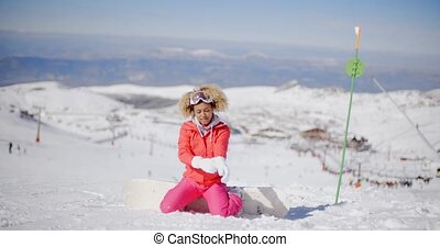 Snowboarder putting on her gloves - Cute female snowboarder...