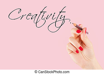 Creative industries. Female hand with pencil writing the...