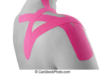 Kinesio tape on female shoulder isolated on white...