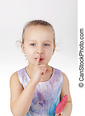 Toothache. Little girl with lollypop.