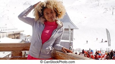 Pretty young woman enjoying her winter vacation at a...