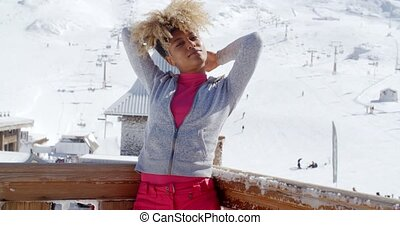 Young woman celebrating the winter season standing on the...