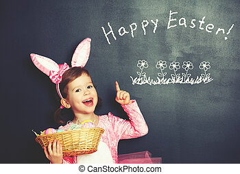 Happy Easter! child girl in costume bunny rabbit with basket...