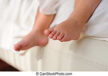 Children's bare feet, sitting on bed - Baby or Children...
