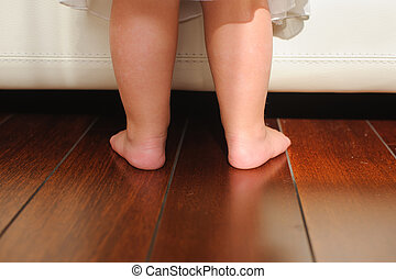 Children's bare feet, beside to bed - Children's...