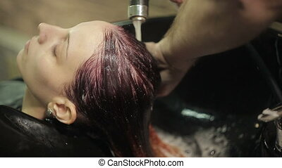 Barber washes the woman's head - Barber washes the girl's...