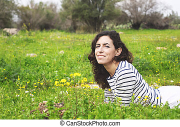 outdoor portrait of a beautiful middle aged woman