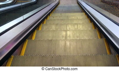 Travel down on Escalator moving staircas