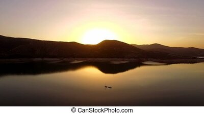 4K Aerial, Sunset at at barrier lake, Andalusia, Spain