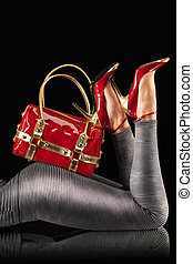 Red handbag and pumps - Red handbag and high heel shoes on a...