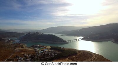 4K Aerial, Flight aloing a barrier lake in Andalusia, Spain...