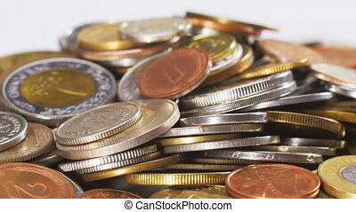 Many old different coins collection heap rotating, loop...