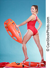 Lifeguard on duty with rescue buoy supervising - Happy...