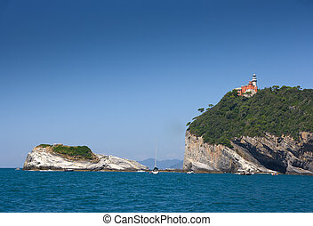 lighthouse on Tino island Tinetto island on the left. Two...