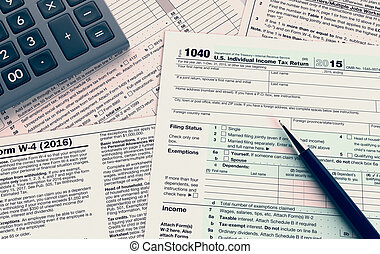 usa taxes concept - top view of forms for usa taxes, with a...