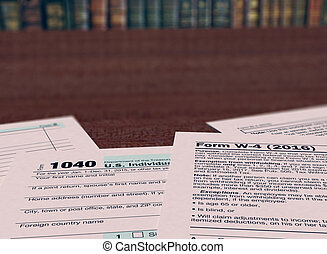 usa taxes concept - close up view of forms for usa taxes and...