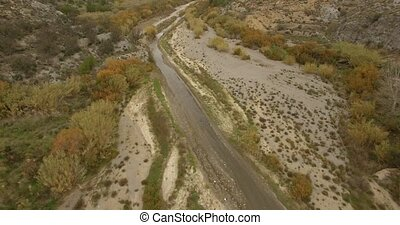 4K Aerial, Flight along a riverbed - Different approaches to...