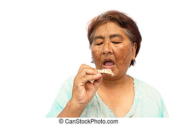Old hoary woman open mouth and prepare to put a denture...