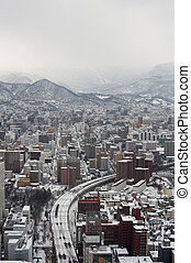 Sapporo city in Japan - View from above down towards highway...