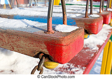 Snow closeup on a red wooden background