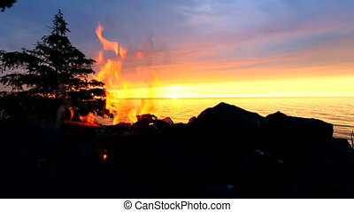 Camp Fire at Great Lakes - Sunset camp fire along a...