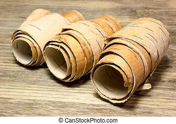 Rolls of birch Bark on wooden