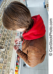 Examining a lock - Man, examining a lock, taken from the...