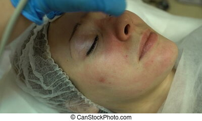 Doctor using apparatus for ultrasonic cleansing - Beautician...