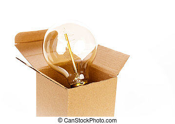 Glowing light bulb over open cardboard box