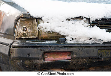 front headlight of an old car in winter