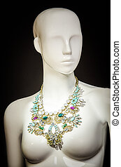 White mannequin with necklace