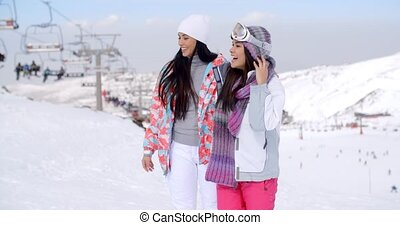 Two pretty young female friends at a ski resort - Two pretty...