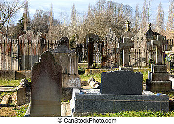 Tombstones in the churchyard of All Saints Anglican Church,...