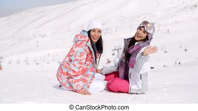 Laughing vivacious young women in snow - Laughing vivacious...