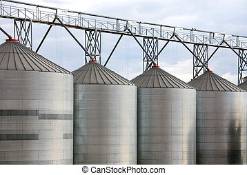 Grain Silos - Galvenised Iron grain silos on a farm in...