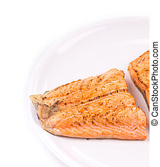 Fried salmon fillet. Close up on the white background.