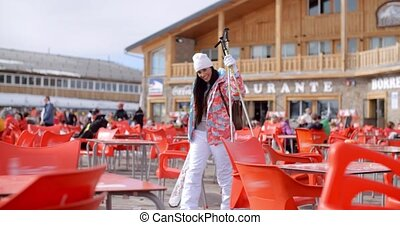 Young woman posing at a ski resort restaurant - Attractive...