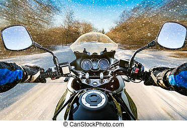 Biker First-person view. Winter slippery road - Biker rides...